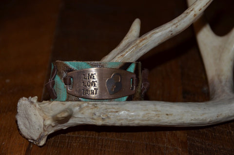 "Handmade antler pattern brown/turquoise leather 1"" cuff with Live Love Hunt tied on tag"