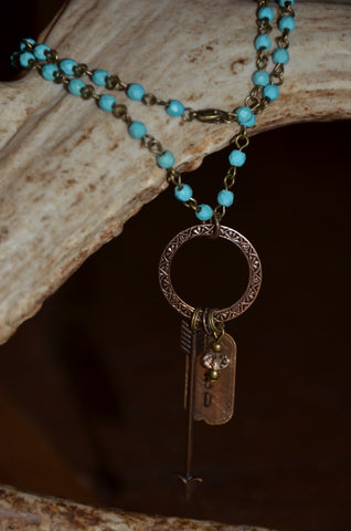 Handmade turquoise beaded necklace with bronze BBD tag and arrow charm