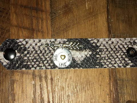 Handmade black/white python print leather cuff with rhinestone arrow and Live Love Hunt Circle dangle tag