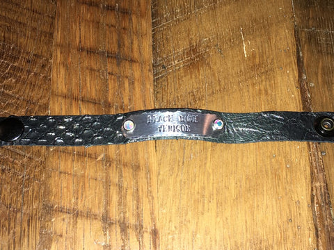 Handmade Black with slight silver shimmer overlay thin leather bracelet with Peace Love Venison tag with swarovski rivets