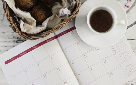 a cup of coffee and a calendar