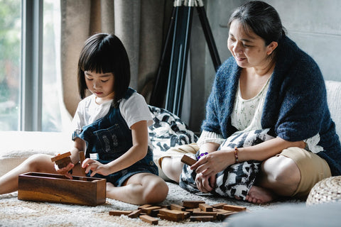 a mom and a child playing a puzzle game