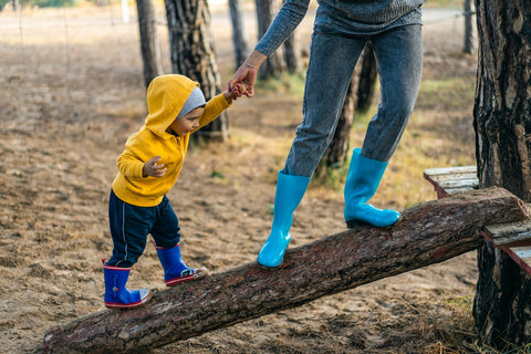 A parent and a child with matching rainboots