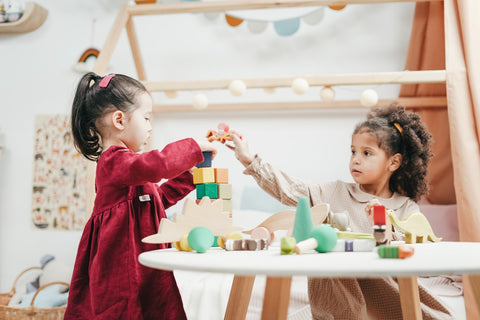 two little girls playing with toys