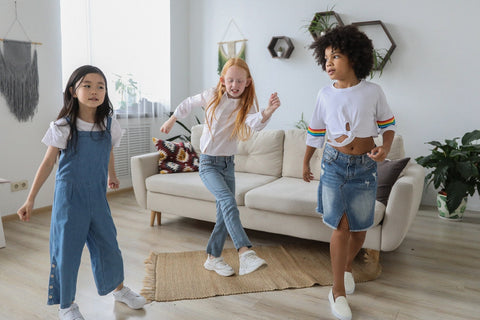 Three girls dancing in a living room