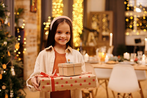 A girl holding Christmas presents