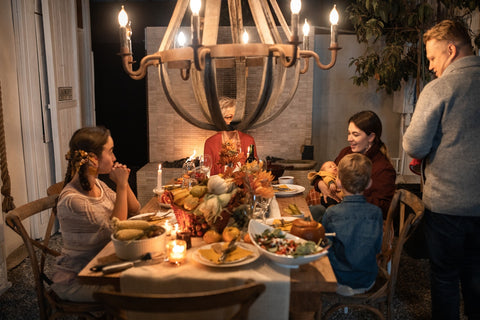 A family gathered around the table during Thanksgiving celebration