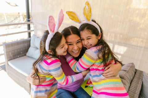 a mother and two daughters celebrating easter