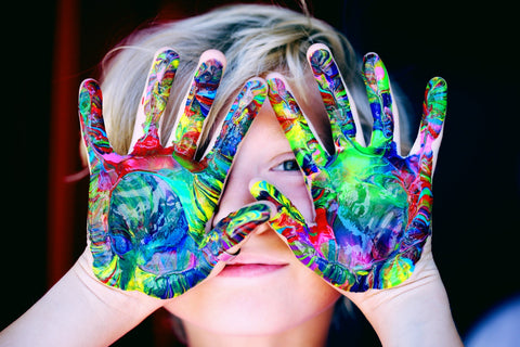 a boy with colorful painted hands
