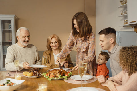 A family sharing a Thanksgiving turkey