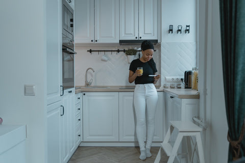 Pregnant woman in the kitchen thinking about how to prepare a home for a new baby