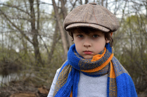 A boy dressed up fashionably for fun winter activities