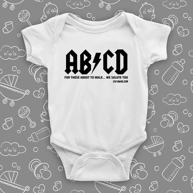"The rock n roll onesies with saying ""ABCD"" in white."