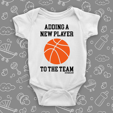 "Unique baby onesies with saying ""Adding A New Player To The Team"" in grey."