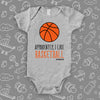 "Cute baby boy onesies with saying ""Apparently, I Like Basketball"" in grey."