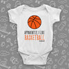 "Cute baby boy onesies with saying ""Apparently, I Like Basketball"" in white."