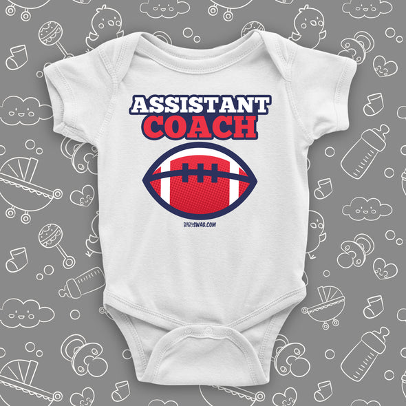 "Cool baby boy onesie saying ""Assistant coach"", in white."
