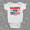 "White cool baby onesie saying ""Babies for Trump""."