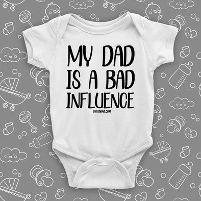 The ''My Dad Is A Bad Influence'' hilarious baby onesies in white.