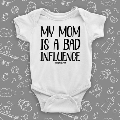 The ''My Mom Is A Bad Influence'' cool baby onesies in white.