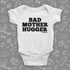 "The ""Bad Mother Hugger"" funny baby onesies in white."