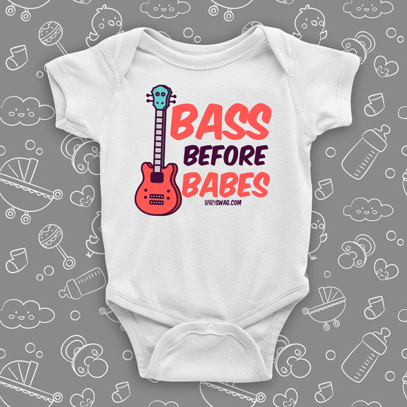 "Cute baby boy onesie with saying ""Bass Before Babes"" in white."