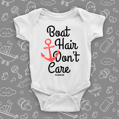 "Cute baby girl onesies with saying ""Boat Hair Don't Care"" in white."