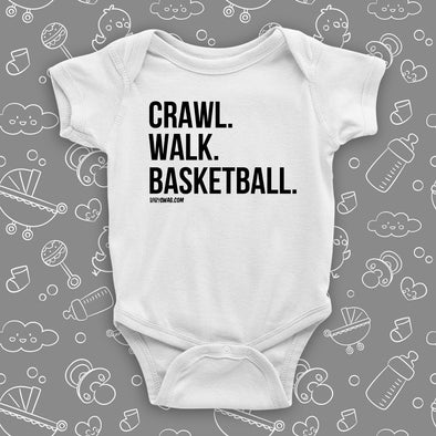 "Cute baby boy onesies with saying ""Crawl. Walk. Basketball"" in white."