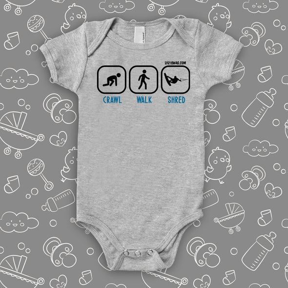 "Cute baby boy onesies with saying ""Crawl. Walk, Shred"" in grey."