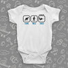 "Cute baby boy onesies with saying ""Crawl. Walk. Shred"" in white."