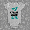 "Unique baby boy onesies with saying: ""Crawl. Walk. Surf"" in grey."