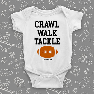 "The ""Crawl. Walk. Tackle"" cute baby onesies in white."