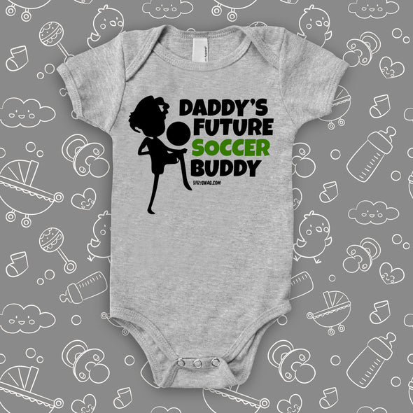 "Cute baby boy onesie with the caption ""Daddy's Future Soccer Buddy"" in grey."