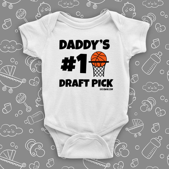 "Cute baby onesies with saying ""Daddy's #1 Draft Pick"" in white."