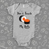 The ''Don't Touch My Rolls'' cool baby onesie in grey.