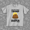 "Funny toddler shirt with the caption ""Dump Trump"" in grey."