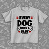 "Toddler graphic tees with saying ""Every Dog Need A Baby"" in grey."
