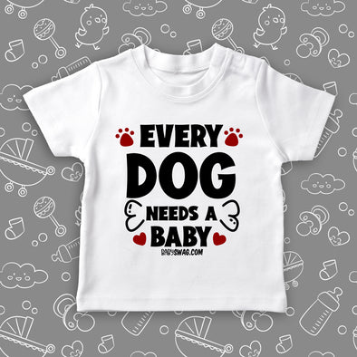 "Toddler graphic tees with saying ""Every Dog Need A Baby"" in white."