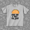 "Funny toddler shirt with taco image and print: ""Every now and then I fall apart"", color grey."