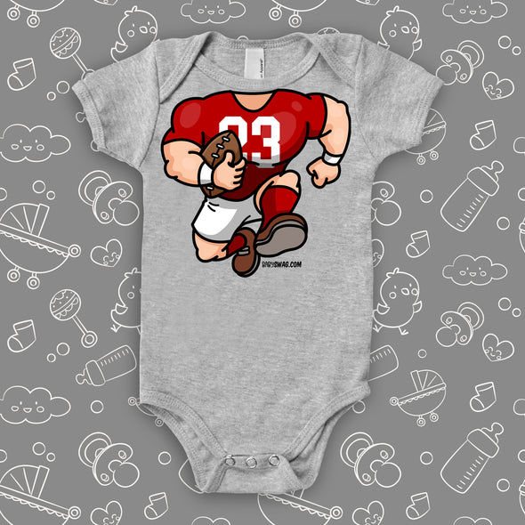 A grey baby boy onesie with football bobblehead