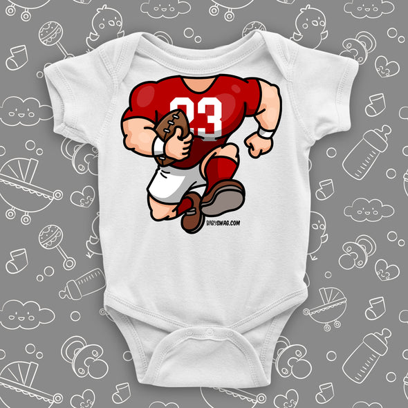 A white baby boy onesie with football bobblehead.