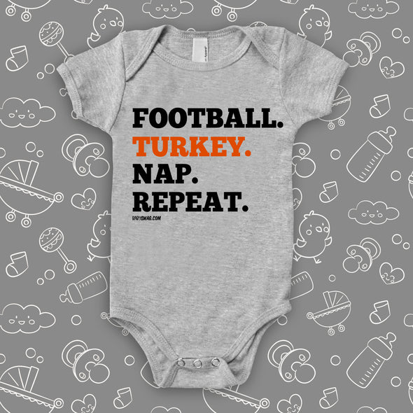 "Cool baby onesies with saying ""Football. Turkey. Nap. Repeat"" in grey."