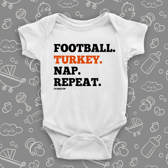 "Cool baby onesies with saying ""Football. Turkey. Nap. Repeat"" in white."