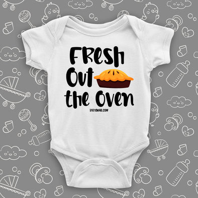 "Cute baby onesies with saying ""Fresh Out The Oven"" in white."