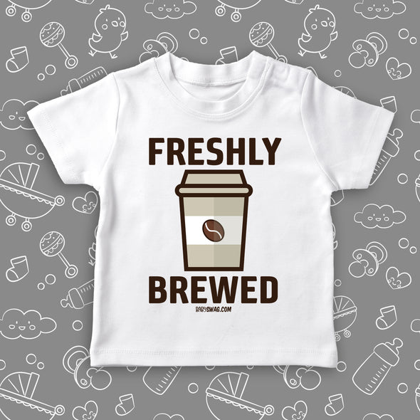 "Cool toddler shirt with ""Freshly brewed"" print and an image of a coffee cup, color white."