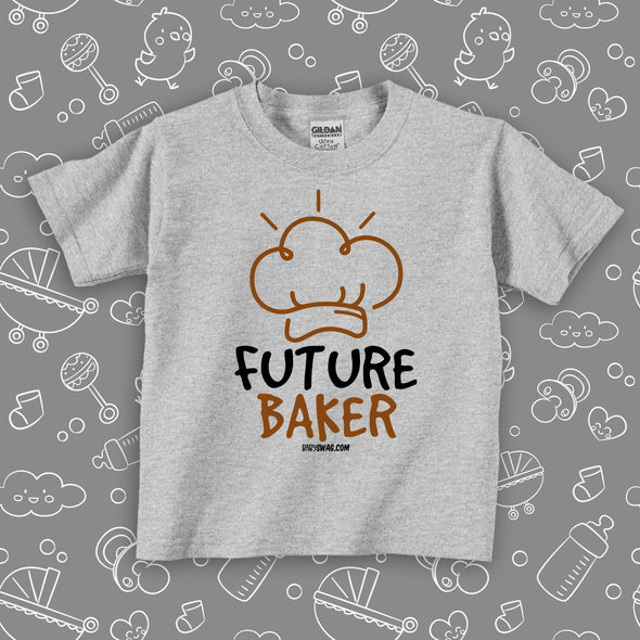 "Grey toddler shirt with ""Future baker"" print and a drawing of baker's hat."