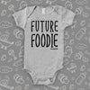 "Unique baby onesie with saying ""Future Foodie"" in grey."