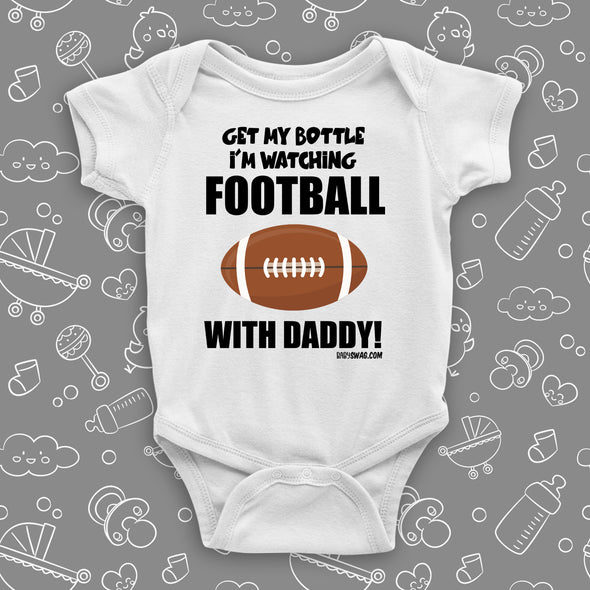 "Cute baby boy onesies with saying ""Get My Bottle I'm Watching Football With Daddy"" in white."