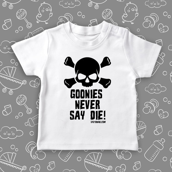 "White cool toddler shirt with an image of a skull and a ""Goonies Never Say Die"" print."
