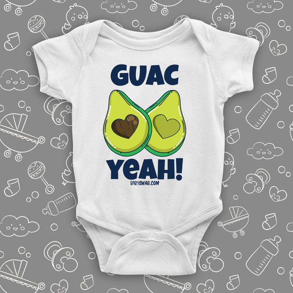 "White unique baby onesie with ""Guac Yeah!"" print and image of avocade with heart-shaped stone."